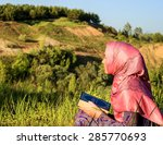 muslim woman reading holy quran ... | Shutterstock . vector #285770693