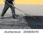 road worker leveling fresh...   Shutterstock . vector #285808193
