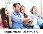 family watching tv and eating... | Shutterstock . vector #285998573