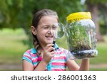 curious little girl looking at... | Shutterstock . vector #286001363