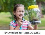 curious little girl looking at... | Shutterstock . vector #286001363
