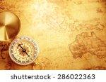 old vintage compass on vintage... | Shutterstock . vector #286022363