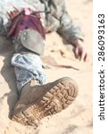Small photo of Wounded US paratrooper airborne infantrymen in the desert