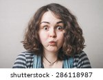Portrait Of A Young Woman With...