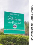 Small photo of Welcome to Alabama the Beautiful sign at the state border