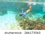 woman with mask snorkeling in... | Shutterstock . vector #286173563