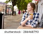Young Woman Enjoying A Beer...