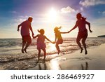 happy family jumping together... | Shutterstock . vector #286469927