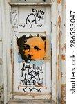 "Small photo of LAGOS, PORTUGAL - MAY 3, 2015: Graffiti portrait of Fado singer Amalia Rodrigues, known as ""Queen of Fado""."