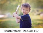 angry little boy  holding sword ... | Shutterstock . vector #286631117