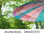 Colorful Umbrella On Natural...