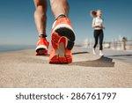 runner feet running on road... | Shutterstock . vector #286761797