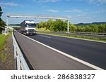 white truck passing through the ... | Shutterstock . vector #286838327