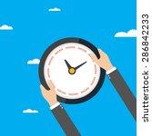 businessman holding a clock... | Shutterstock .eps vector #286842233