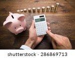 Businessman Using Calculator...