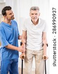 kind male nurse helping senior... | Shutterstock . vector #286990937