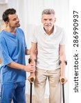 kind male nurse helping senior... | Shutterstock . vector #286990937
