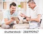 smiling handsome man taking... | Shutterstock . vector #286990967