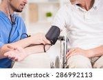 male doctor measuring blood... | Shutterstock . vector #286992113