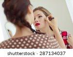make up artist doing...   Shutterstock . vector #287134037