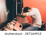 man losing at slot machines in... | Shutterstock . vector #287164913