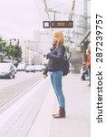 german blonde girl at tram stop ... | Shutterstock . vector #287239757