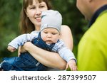 happy baby on the mother's... | Shutterstock . vector #287399507