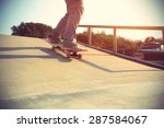 skateboarder legs riding... | Shutterstock . vector #287584067