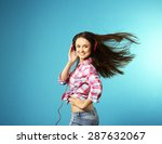 young woman with headphones on... | Shutterstock . vector #287632067