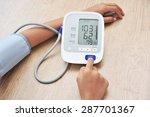 female measures her blood... | Shutterstock . vector #287701367