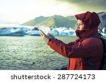 woman is holding a piece of ice ... | Shutterstock . vector #287724173