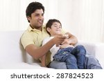 happy father and son watching...   Shutterstock . vector #287824523