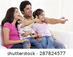family of four watching... | Shutterstock . vector #287824577