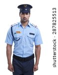 Small photo of Male security guard standing over white background
