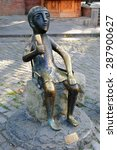 Small photo of GEORGIA, TBILISI - August 5, 2013: Tamada - Bronze copy of sculpture toastmaster in the old center of Tbilisi