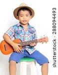 Small photo of Boy playing acoustic ukulele on a white background.