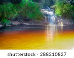 Small photo of Regular orange tones water from Ibitipoca Park, Minas Gerais, Brazil. The color is a result of plants decomposition.