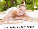 peaceful blonde lying on towel... | Shutterstock . vector #288268403