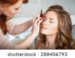 Makeup Artist Preparing Bride...