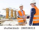 engineers shaking hands at... | Shutterstock . vector #288538313
