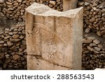 Small photo of Stylised carvings at Gobekli Tepe archaeological site at the top of a mountain ridge in the Southeastern Anatolia Region of Turkey.