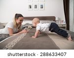 happy mother playing with her... | Shutterstock . vector #288633407