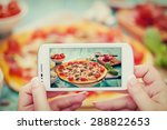 woman taking a photo of pizza... | Shutterstock . vector #288822653