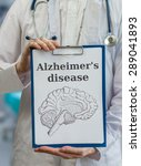 Small photo of Neurologist doctor holds clipboard with Alzheimer's disease and brain drawing to explain dementia