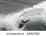 A Surfer Wipes Out In...