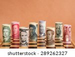 Stock photo currency war photo shows banknotes from different countries on a chess board 289262327