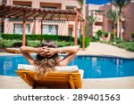 woman lying on a lounger by the ... | Shutterstock . vector #289401563