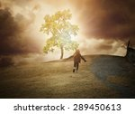 a little child is running up a... | Shutterstock . vector #289450613