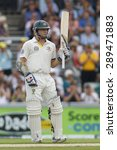 Small photo of MANCHESTER, ENGLAND - August 01 2013: Chris Rogers raises his bat to acknowledge the crowd after scoring a half century during day one of the Ashes 3rd test match at Old Trafford Cricket Ground