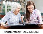 Grandmother Looking At Photo...